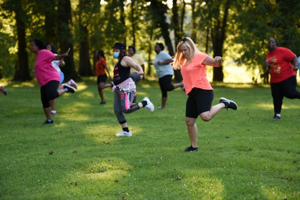 Participants dance during a Zumba class on Tuesday evening at the River Walk Soccer Complex in Columbus. Bonnie Partridge's class is free and open to anyone on Tuesdays and Thursdays at 6:30 p.m. at the River Walk Soccer Complex. / Photo by: Claire Hassler/Dispatch Staff