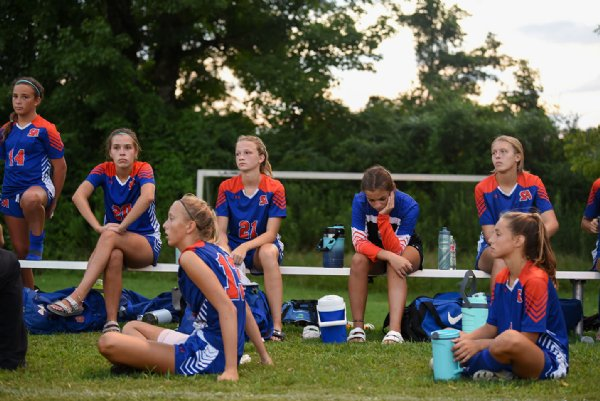 Starkville Academy soccer players listen to Coach John Morgan after losing 0-8 to Hartfield Academy on Tuesday in Starkville. / Photo by: Claire Hassler/Dispatch Staff