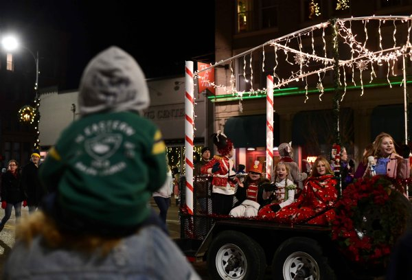 The Columbus Girl Scouts wave to onlookers as they ride down Main St. on their Nutcracker themed float Dec. 2 in Columbus. / Photo by: Jennifer Mosbrucker/Dispatch Staff