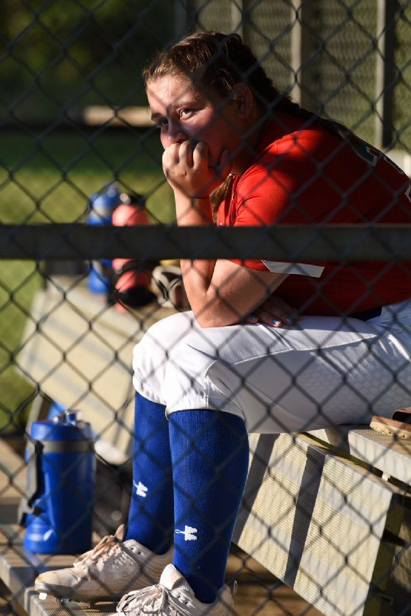 Freshman Anna Harrell watches her teammates bat during a softball game against Oak Hill Academy on Monday at Oak Hill Academy in West Point. / Photo by: Claire Hassler/Dispatch Staff