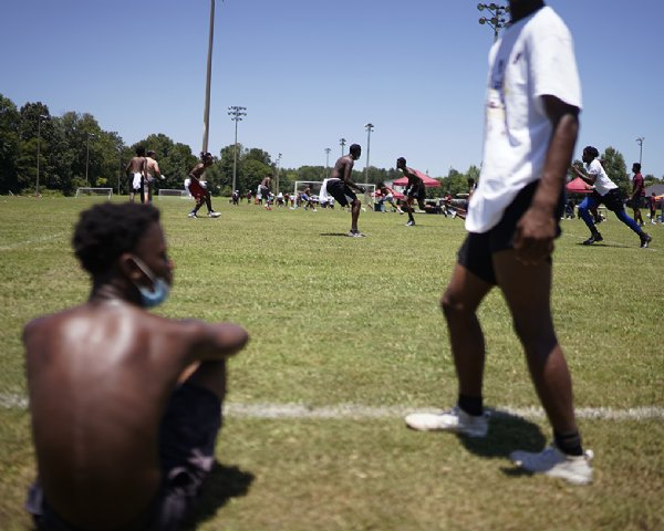 Players run a seven versus seven training drill during the Jeffery Simmons Football camp on Saturday at the Starkville Sportsplex in Starkville. / Photo by: Anto Tavitian/Dispatch Staff
