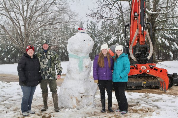 From left, Jill, Tim, Emma and Anna Kate O'Bryant of New Hope pose with the finished product from their snowman building adventure in New Hope. / Photo by: Courtesy photo
