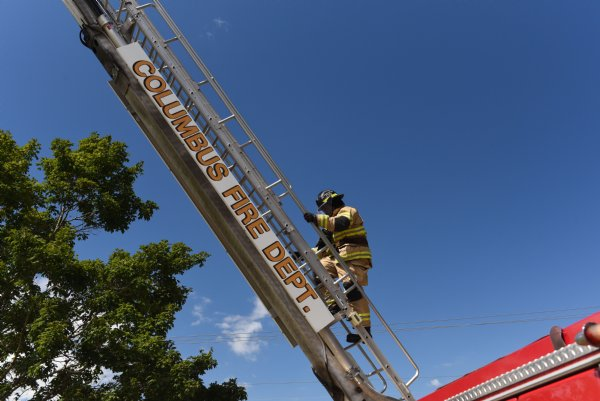 Justin Martin climbs the ladder on Friday during training outside Fire Station 3 in Columbus. Martin will go to the Mississippi Fire Academy in Jackson to take a test to become a truck operator, but he isn't sure when due to COVID-19. / Photo by: Claire Hassler/Dispatch Staff