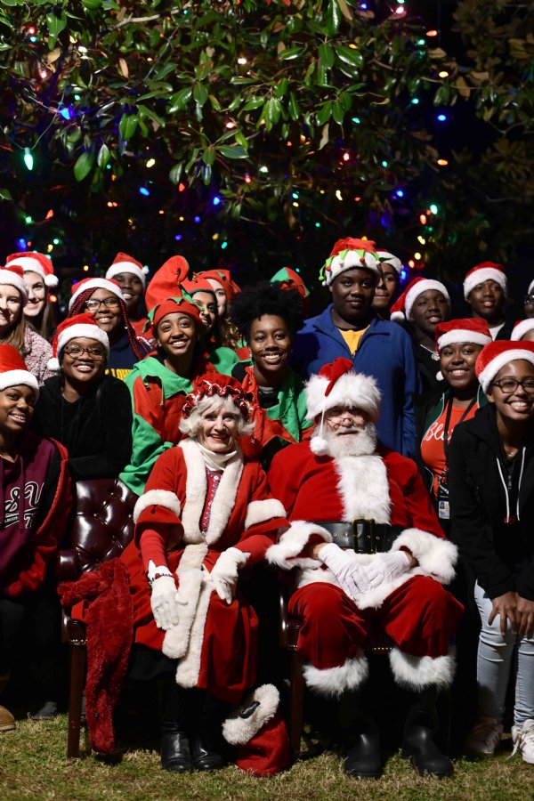 Members of the Columbus Mayor's Youth Council smile with Miz Claus and Santa Claus following the tree lighting ceremony Dec. 5, when the mayor flipped the lights on for the Christmas tree by the Columbus Riverwalk. / Photo by: Jennifer Mosbrucker/Dispatch Staff