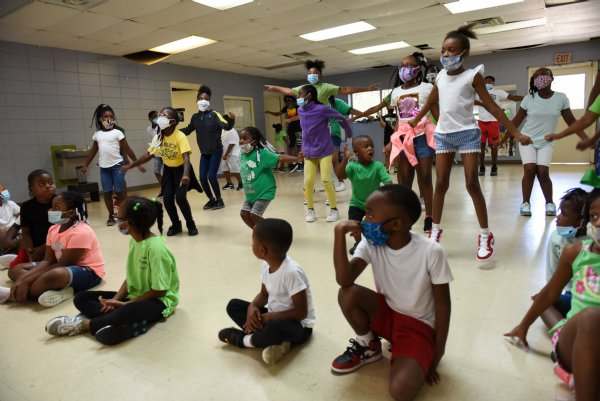 Campers of Ms. Smith's Academic Summer Camp perform a praise dance on the last day of camp on July 24 at the Needmore Center in Starkville. The campers worked on the dance all summer, and Tonya Davis, co-director of the camp, said the performance is the culmination of all their teamwork and collaboration. The dance was choreographed by Mya Halbert, who is one of the camp's high school students and who is heading to college in the fall. / Photo by: Claire Hassler/Dispatch Staff