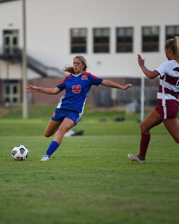 Starkville Academy Sophomore Meredith Reed kicks the ball during a soccer game against Hartfield Academy on Tuesday in Starkville. / Photo by: Claire Hassler/Dispatch Staff