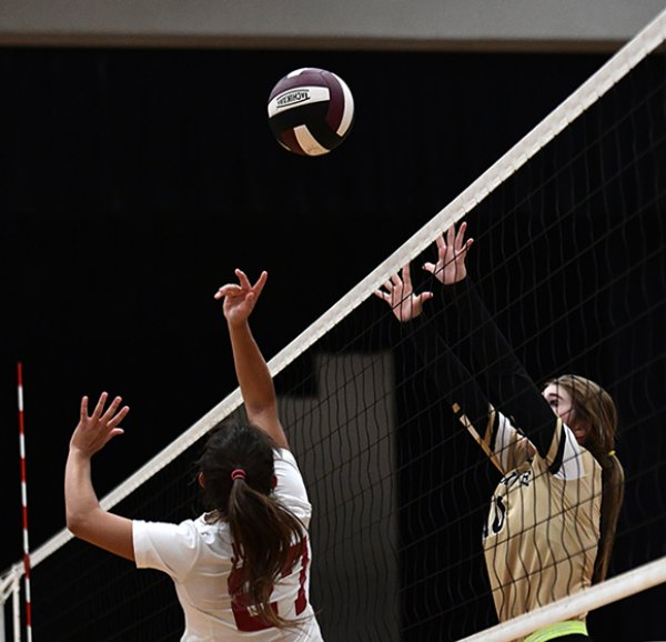 New Hope's Zoe Goodman, right, attempts to block the ball as Caledonia's Camryn Johnson hits it over the net during the final set of a game Oct. 10 at Caledonia High School. The Confederates won the third set 25-22. / Photo by: Jennifer Mosbrucker/Dispatch Staff