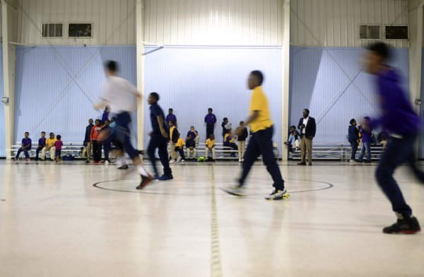 Students and mentors run across the court during a basketball scrimmage Nov. 1 at the Boys & Girls Clubs of Columbus. / Photo by: Jennifer Mosbrucker/Dispatch Staff