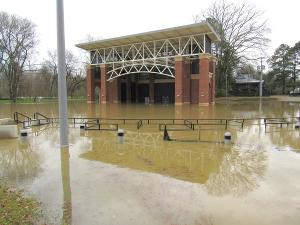 Flood waters rise above the stage of the Terry Brown Amphitheater Wednesday afternoon. It is the second year in a row the amphitheater has flooded. / Photo by: Slim Smith/Dispatch Staff