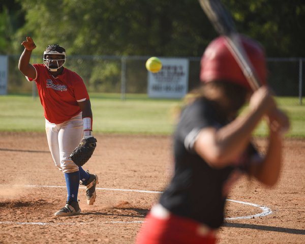 8th grader Jeoreia Henry pitches the ball during a softball game against Oak Hill Academy on Monday at Oak Hill Academy in West Point. / Photo by: Claire Hassler/Dispatch Staff