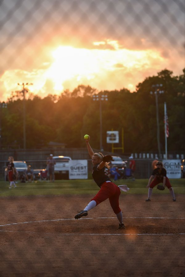 Carley Wooten pitches the ball during a softball game against Heritage Academy on Monday at Oak Hill Academy in West Point. / Photo by: Claire Hassler/Dispatch Staff