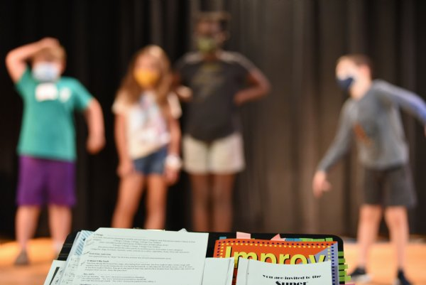 From left, Charlie Clemons, 7, Annabelle Brislin, 8, Leah Jeremiah, 12, and Kanat Sarp, 7, practice improv during the Atmos Energy Summer Arts Academy on Thursday at the Columbus Arts Council. / Photo by: Claire Hassler/Dispatch Staff