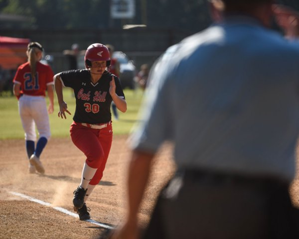 Carley Wooten runs to third base during a softball game against Heritage Academy on Monday at Oak Hill Academy in West Point. / Photo by: Claire Hassler/Dispatch Staff