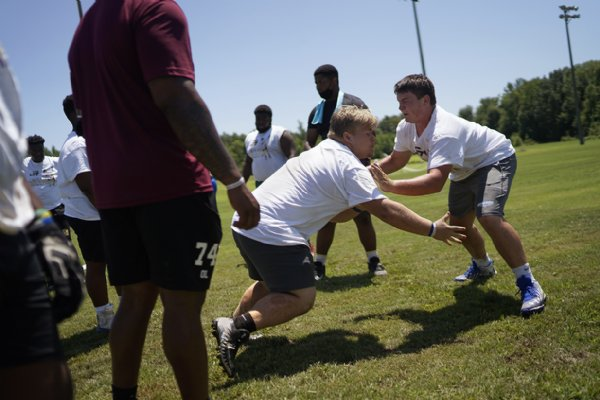 Will Chapman, a sophomore nose guard at Caledonia High School, runs a drill during the Jeffery Simmons Football camp on Saturday at the Starkville Sportsplex in Starkville. / Photo by: Anto Tavitian/Dispatch Staff