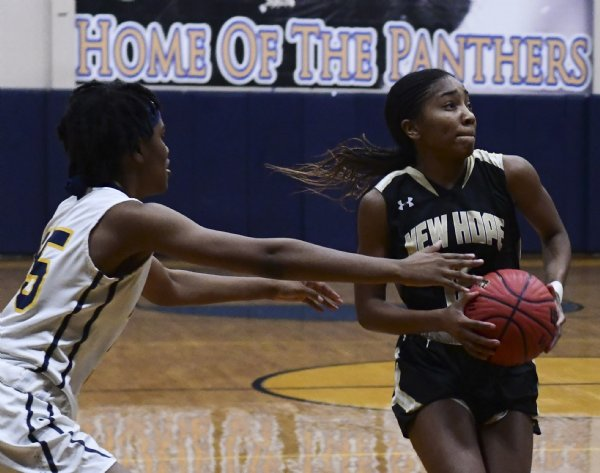 New Hope's Imoni Harris attempts a layup during a game against West Lowndes Nov. 30 at West Lowndes High School. / Photo by: Jennifer Mosbrucker/Dispatch Staff