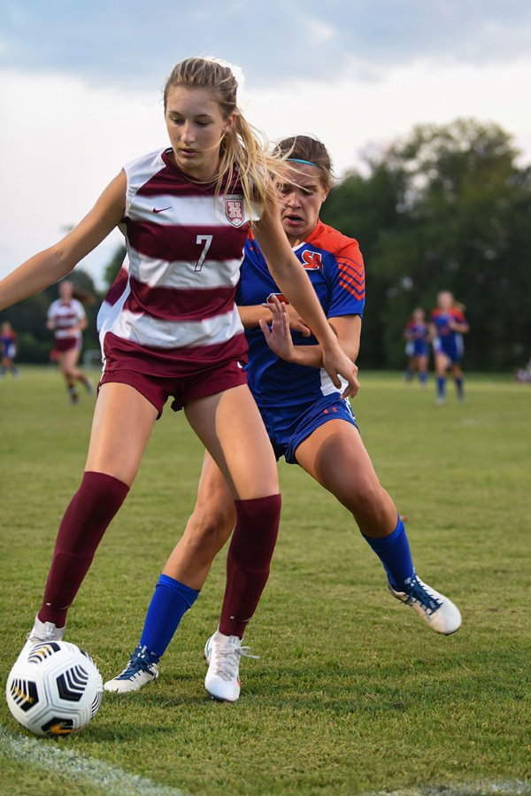 Starkville Academy 8th grader Sara Stokes McReynolds tries to get the ball from a Hartfield Academy player during a soccer game against Hartfield Academy on Tuesday in Starkville. / Photo by: Claire Hassler/Dispatch Staff