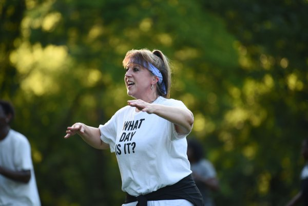 Jennifer Garrard dances during a Zumba class on Tuesday evening at the River Walk Soccer Complex in Columbus. The class was led by Bonnie Partridge, who normally teaches classes at gyms in Columbus and at New Hope, but since COVID-19 hit she's opted for outdoor classes. / Photo by: Claire Hassler/Dispatch Staff