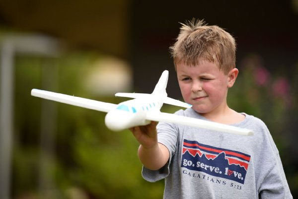 Cameron Blissard, 5, squints to aim his toy airplane before throwing it on July 29 outside Oak Hill Academy in West Point. / Photo by: Claire Hassler/Dispatch Staff