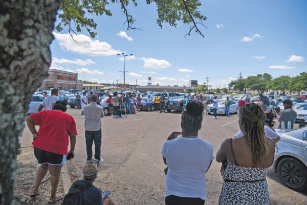 A crowd of roughly 250 people, some standing in a loose circle and others listening from their cars, gathered near the main entrance at Leigh Mall Saturday to protest Attorney General Lynn Fitch's decision to drop the manslaughter charge against former Columbus Police Department officer Canyon Boykin in the 2015 shooting death of Ricky Ball. / Photo by: Deanna Robinson/Dispatch Staff