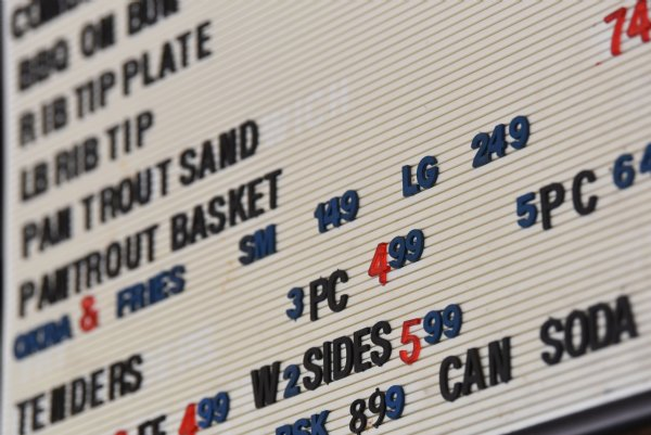 The menu inside Skeet's Hotdogs, as shown on Friday in Columbus. Sylvia Graham, owner of Skeet's Hotdogs, said fluctuating prices of products due to COVID-19 has impacted her business, especially Italian beef, which she said went up from $3 to $7 per pound in April. / Photo by: Claire Hassler/Dispatch Staff