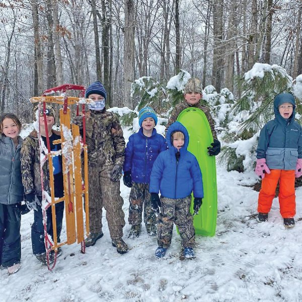 From left, Julia Yeatman, 8; Rhett Galjour, 9; Barrett Spears, 8; Tate Galjour, 7; Henry Spears, 4; Pearson Spears, 7; and Hudson Yeatman, 4, take a break from sledding. Julia and Hudson are the children of Luke and Laura Catherine Yeatman. Rhett and Tate are the children of Chris and Morgan Galjour. Barrett, Henry, and Pearson are the children of Jason and Paige Spears. / Photo by: Courtesy photo
