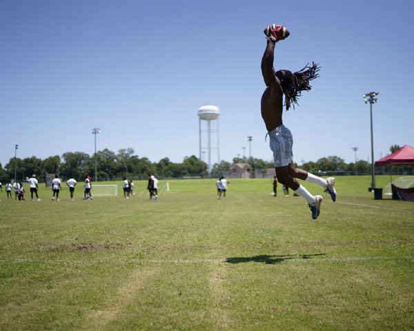 Dequadrion Welch, a ninth-grade receiver at Noxubee County High School, catches the ball during a drill at the Jeffery Simmons Football camp on Saturday at the Starkville Sportsplex in Starkville. / Photo by: Anto Tavitian/Dispatch Staff