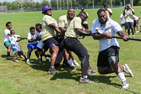 Jeffery Simmons, far right, leads his team in a tug-of-war competition on Friday during the Jeffery Simmons Football camp at the Starkville Sportsplex in Starkville. Simmons is a Noxubee County High School and Mississippi State alum and now plays for the Tennessee Titans in the National Football League. / Photo by: Claire Hassler/Dispatch Staff