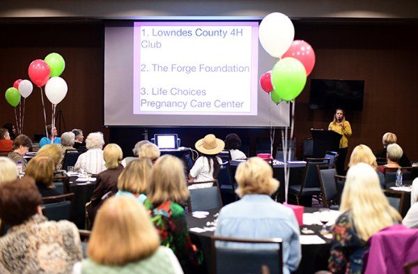 Katie McCrary speaks on behalf of the Forge Foundation to members and guests at the 100+ Women Who Care Impacts Awards Oct. 22 at the Courtyard by Marriott. The Forge Foundation was awarded $13,900 during the biannual award ceremony. / Photo by: Jennifer Mosbrucker/Dispatch Staff