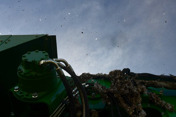 Cotton flies through the air above the cotton picker as it is harvested on Oct. 18 off Plymouth Road near Columbus. / Photo by: Jennifer Mosbrucker/Dispatch Staff