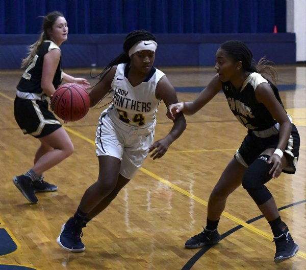 West Lowndes' Marvaysha Seals drives the ball toward the net during the first quarter of a game against New Hope Nov. 30 at West Lowndes High School. / Photo by: Jennifer Mosbrucker/Dispatch Staff