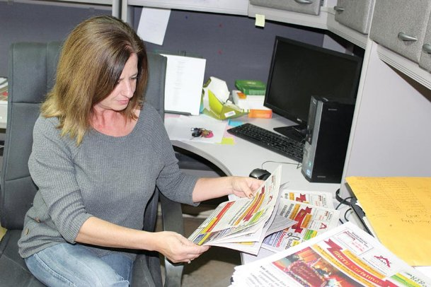 Stephanie Minor looks through copies of the latest edition of the weekly Lamar Leader in Sulligent, Alabama on Friday. Minor, who started working there in 1998 as a typesetter, became the newspaper's owner on Dec. 20.