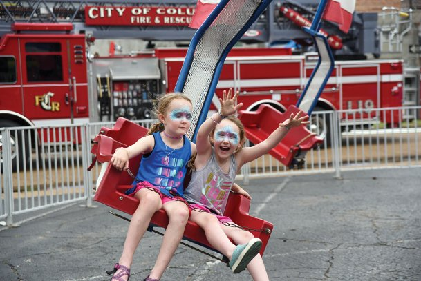 Ella Margaret Sims, 8, and Bailey Stafford, 7, have a blast during the 2019 Market Street Festival in Columbus. This year's festival has been postponed until Sept. 11-12 following the guidance of the National Centers for Disease Control for mass gatherings and large community events. Ella Margaret is the daughter of Randall and Jennifer Sims. Bailey is the daughter of Kevin and Shannon Stafford.