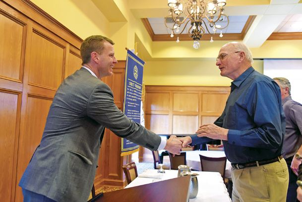 Mike Hurst, left, visits with Frank Howell after speaking during the Columbus Rotary Club's Tuesday meeting at Lion Hills.
