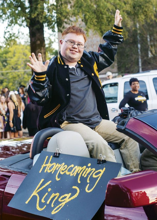 Starkville High School senior Owen Hardin rides in the Homecoming parade in downtown Starkville Thursday after being elected Homecoming King at SHS. Hardin, who has Down's Syndrome, is the first student elected as homecoming king in several years.