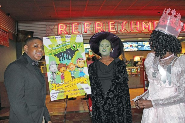 Columbus Municipal School District math coach and former librarian LaToria Johnson, right, dressed as Glinda from the 1939 film