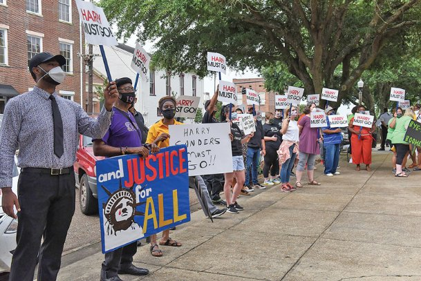Protesters gather outside the Lowndes County Courthouse on Tuesday morning before a supervisors meeting to demand Harry Sanders' resignation in response to racist remarks he made about African Americans June 15.