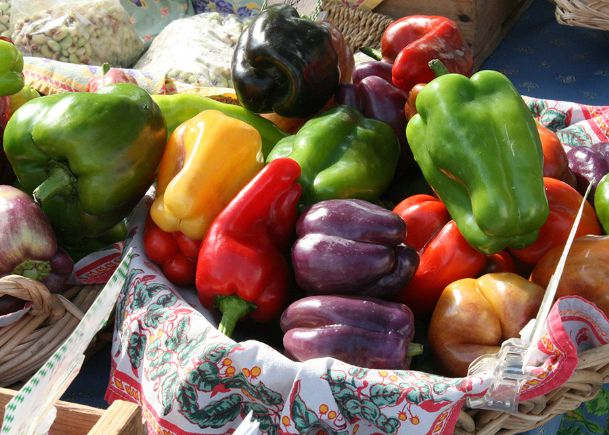 All peppers start off green, and then some mature to shades of red, yellow, orange and even purple, as seen in these bell peppers.