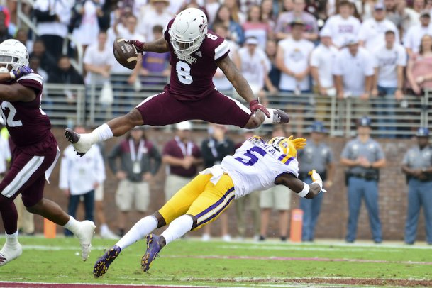 Mississippi State running back Kylin Hill (8) hurdles LSU cornerback Kary Vincent Jr. (5) during the first quarter Oct. 19 at Davis Wade Stadium in Starkville. The Bulldogs open their season Sept. 26 at LSU in Baton Rouge.
