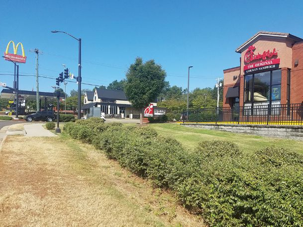 A strip of sidewalk ends abruptly in front of Chick-fil-A at the intersection of Highway 12 East and Spring Street. The city will being construction in about a month to extend the sidewalk by 112 feet, one of three such projects along the highway.