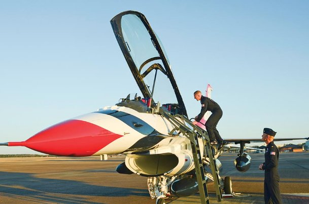 U.S. Air Force Thunderbird pilot TSgt. Joe Khoda climbs into the canopy of his F-16 while visiting Columbus Air Force Base in this 2014 Dispatch file photo. CAFB will host the
