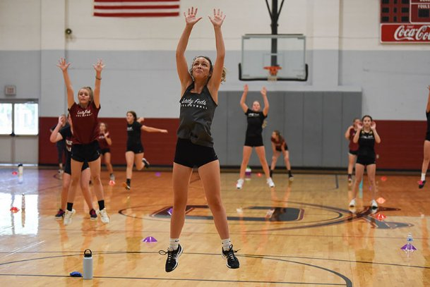 """Senior Ella Clark practices blocking during volleyball summer workouts on Wednesday at Caledonia High School. """"I have faith in us this year,� Clark said of their upcoming season."""