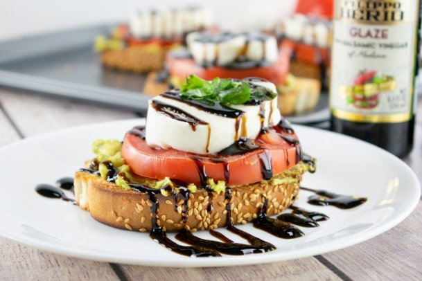 Carprese avocado toast with balsamic glaze makes an impressive appetizer or snack.