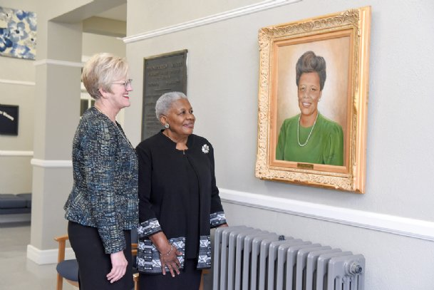 Mississippi University for Women President Nora Miller and Alma Turner admire a portrait of Turner that hangs outside her old office in Turner Hall, formerly the Demonstration School, on MUW's campus Friday. Turner was a principal of the Demonstration School for 10 years.