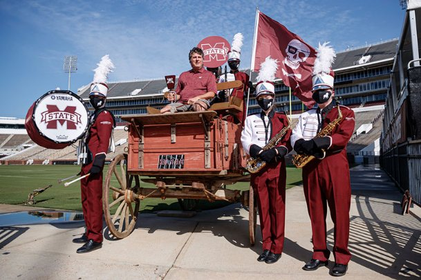 In an effort to recruit idle Big Ten and Pac 12 fans to their side, MSU marketing created a video of Mike Leach riding a bandwagon. The video was posted at an opportune time on Monday following the Bulldogs' upset victory over LSU last Saturday.