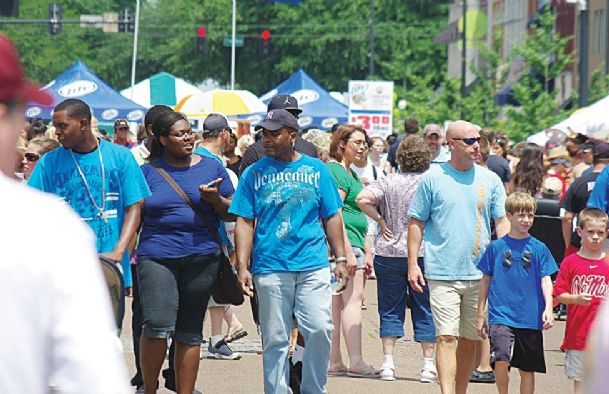 A crowd of festival-goers converge on downtown Columbus during a previous Market Street event. This year's festival begins Friday evening.