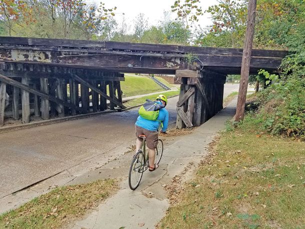 Christopher Ellzey bikes toward the bridge where the railroad crosses Washington Street, where he lives. Ellzey said he would consider using the railroad tracks to bike to and from the Mississippi State University campus, where he is a graduate student, if the city succeeds in turning the rails into a trail.