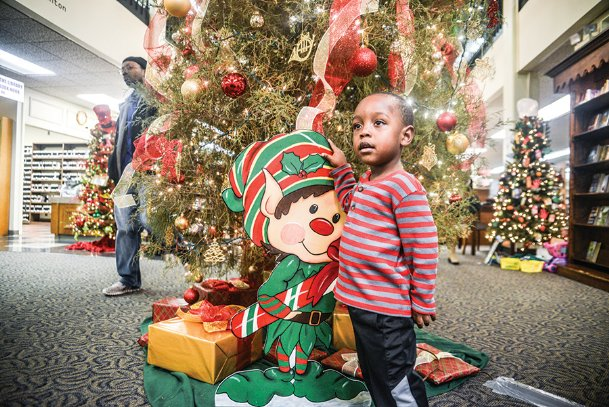 Jalyn Butler, 3, admires the Christmas decorations at the Columbus-Lowndes Public Library during the Annual Festival of Trees in this 2014 Dispatch file photo. Jalyn is the son of Cassandra Butler, of Columbus.