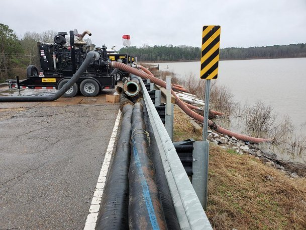 Diesel-fueled pumps siphon water from the Oktibbeha County Lake dam at 30,000 gallons per minute in this Dispatch file photo from January. County officials announced Tuesday the lake has risen 8.5 feet and is still rising.
