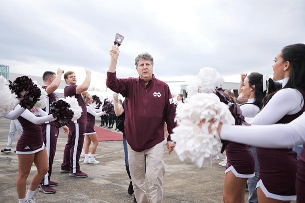 Mike Leach rings a cowbell for fans Thursday at George M. Bryan Airport in Starkville during a welcome ceremony for the newly-hired Mississippi State head football coach. The pirate emblem on the bell is an ode to Leach's love for pirate lore. Leach replaces Joe Moorhead, who was fired after only two seasons leading the Bulldogs.