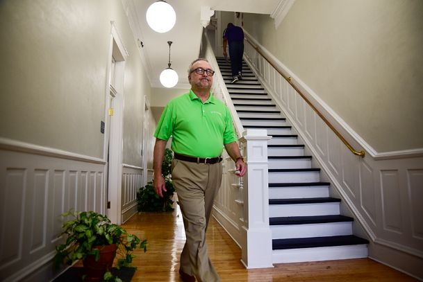 Columbus Chief Operations Officer David Armstrong walks to his office in the newly-renovated City Hall building downtown on Thursday. The $1.9 million project took more than a year to complete.